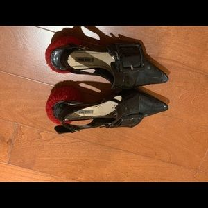 Miu Miu black shoes with red fluffy heels